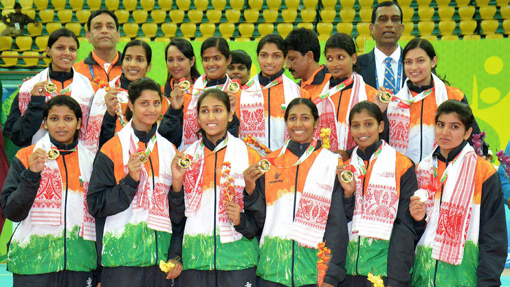 Indian team players pose for a group photograph after their win against Sri Lanka in the women's volleyball event at 12th South Asian Games 2016 in Guwahati on Tuesday. (Photo: PTI)