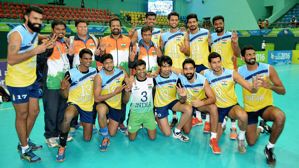 Players and officials of Indian Volley Ball team celebrate after defeating Sri Lanka in the final match at 12th South Asian Games 2016 in Guwahati on Tuesday. (Photo: PTI)