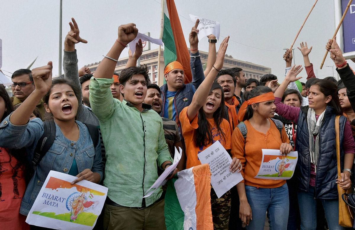 ABVP activists protest against an event at JNU supporting Parliament attack convict Afzal Guru in New Delhi on Friday. (Photo: PTI)