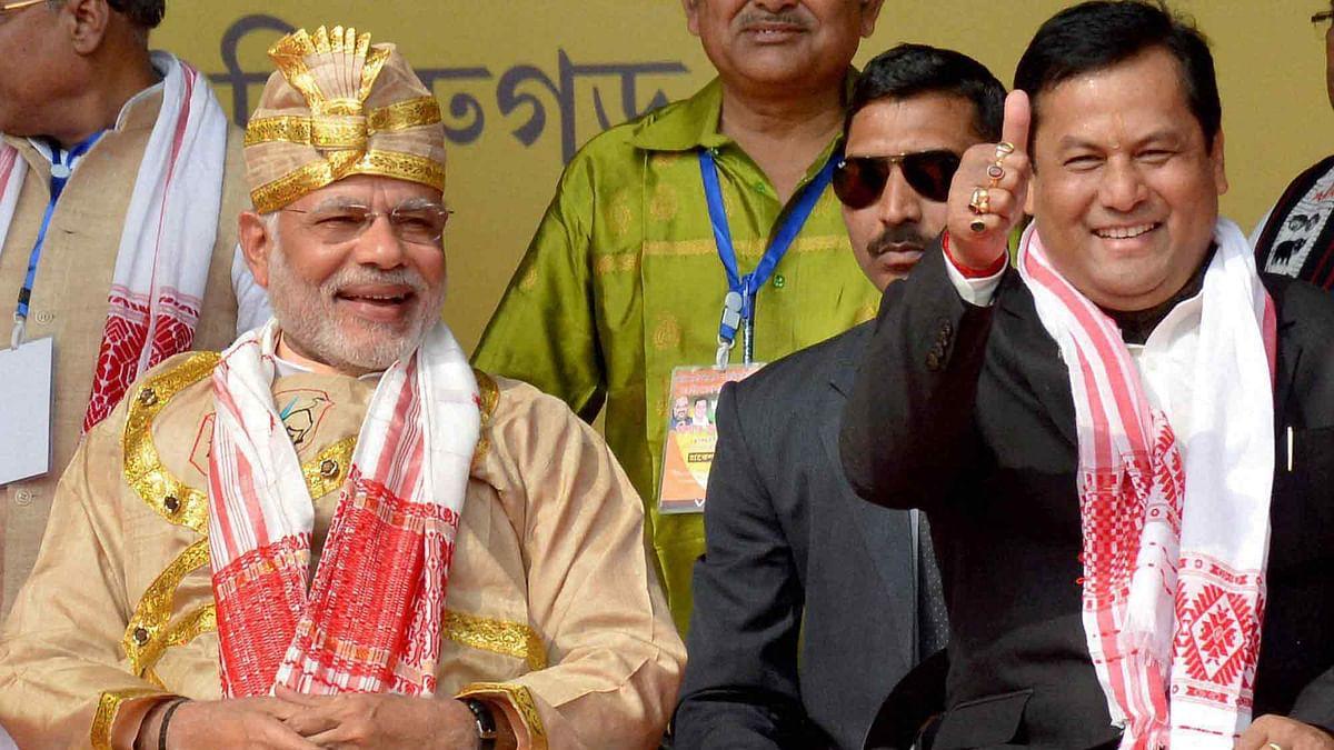Prime Minister Narendra Modi along with Assam CM Sarbananda Sonowal. (Photo: PTI)