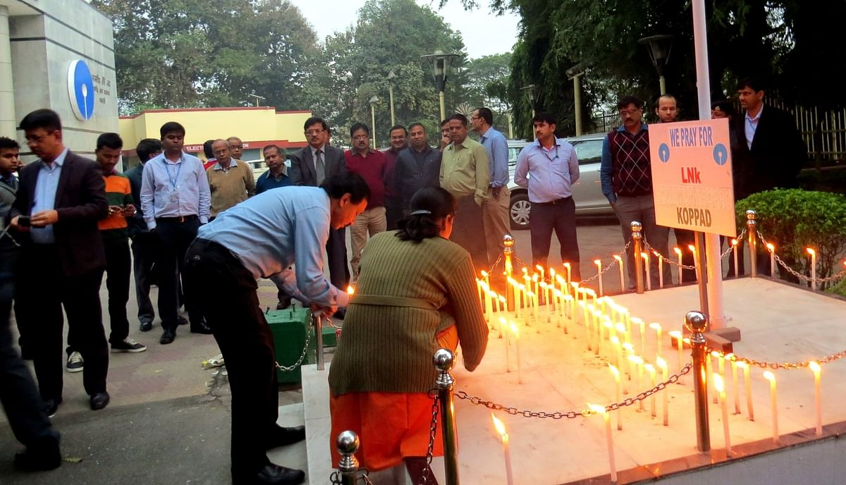 SBI employees in Guwahati pray for Lance Naik Hanumanthappa. (Photo: IANS)