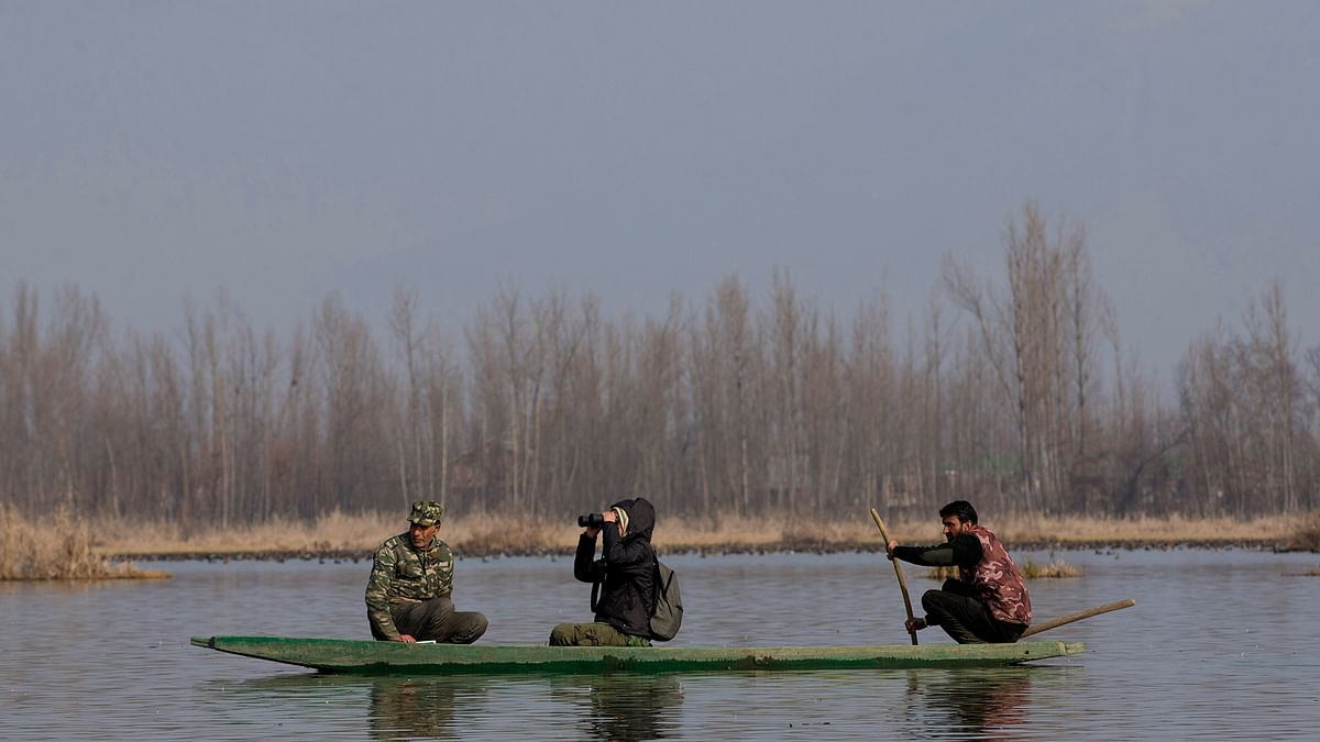 Volunteers and officials participate in the monitoring of water-bird population at Hokersar. (Photo: AP)