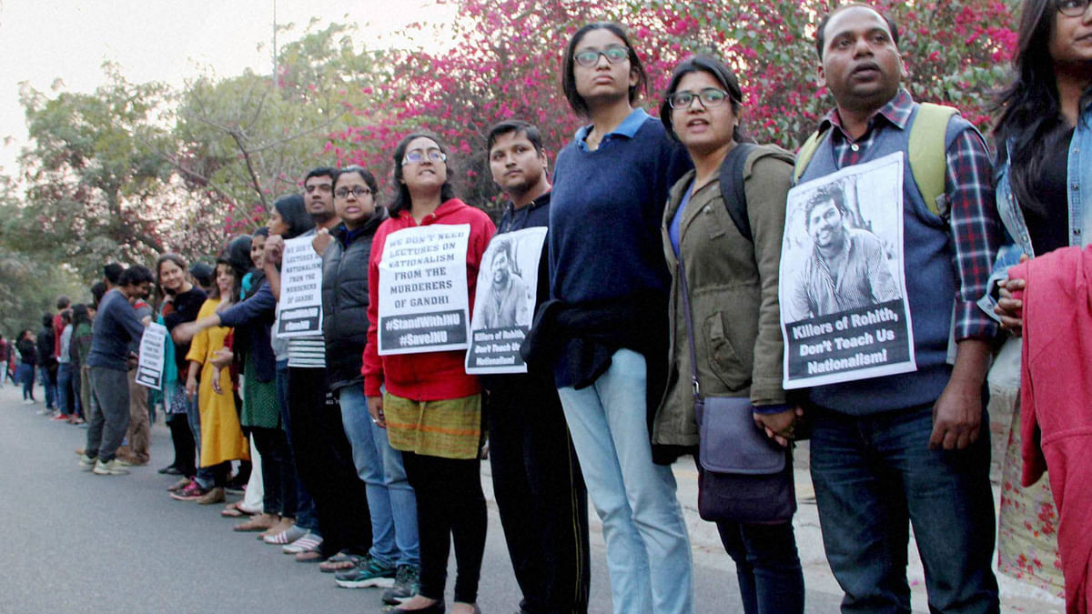 JNU teachers and students form a human chain inside the campus to protest JNUSU President Kanhaiya Kumar's arrest in New Delhi.