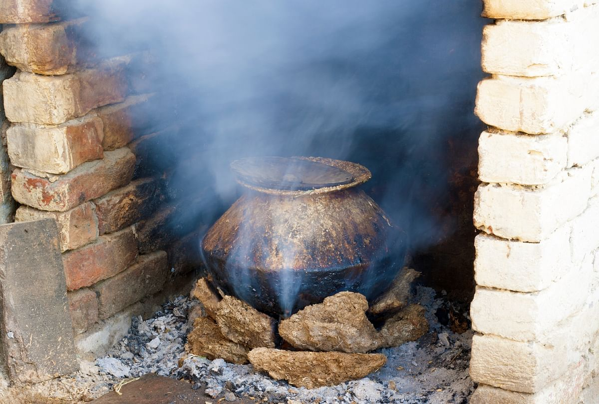 A major contributor to poor air quality is burning wood, dung and similar sources of biomass for cooking. (Photo: iStockphoto)