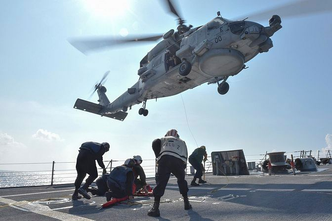 US Navy Sailors participate in a medical training exercise on the deck of the Arleigh Burke-class guided missile destroyer USS Lassen (DDG 82) with an MH-60R Seahawk helicopter in the South China Sea, 28 October 2015, provided by the US Navy. (Photo: Reuters)