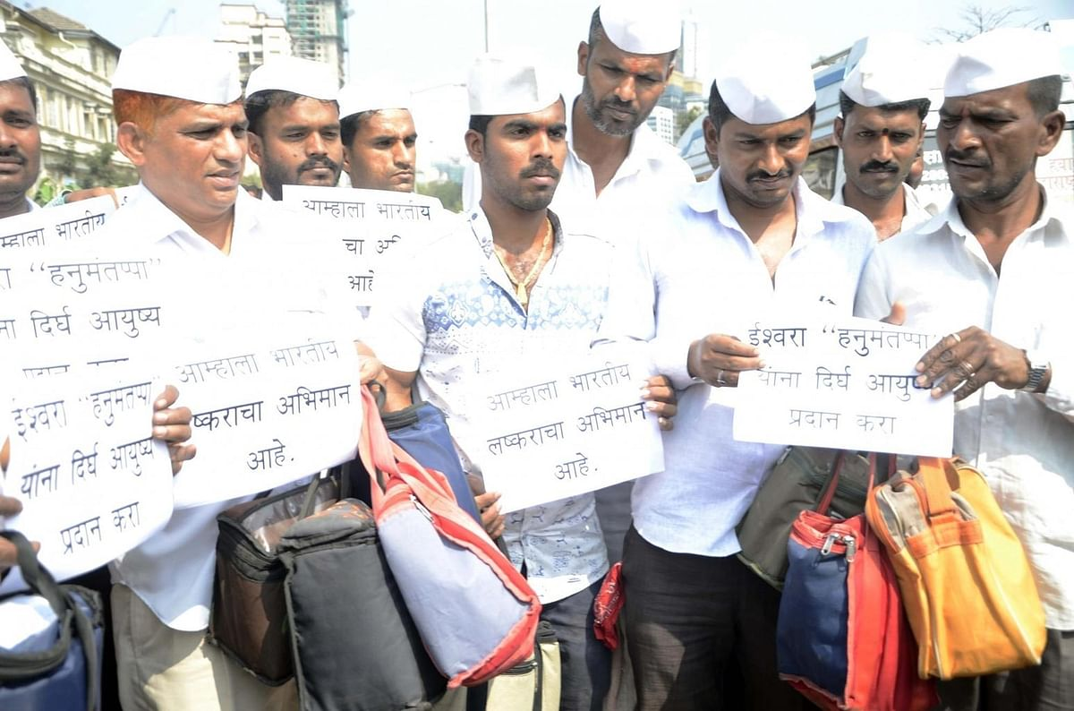 The famed Mumbai dabbawallahs pray for Hanumanthappa's recovery. (Photo: IANS)