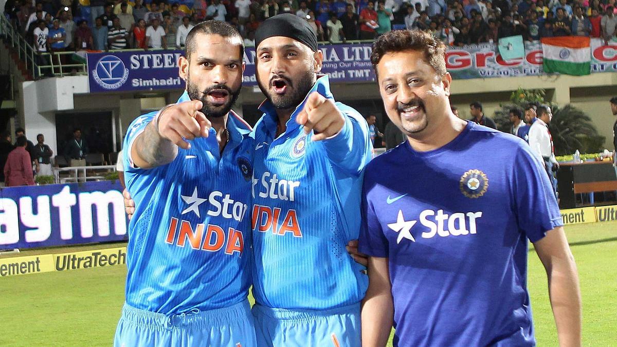 Shikhar Dhawan and Harbhajan Singh celebrate the win in Visakhapatnam. (Photo by: Ron Gaunt / BCCI / Sportzpics)