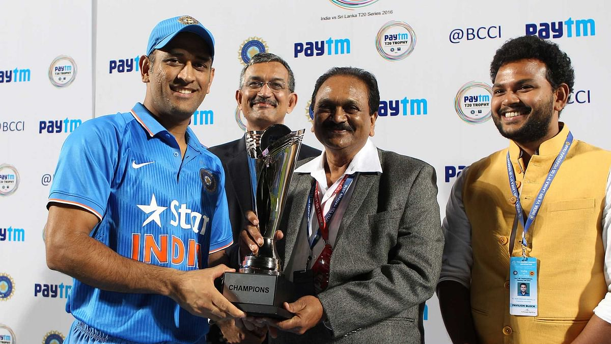 MS Dhoni with the series trophy following the win over Sri Lanka. (Photo by: Ron Gaunt / BCCI / Sportzpics)
