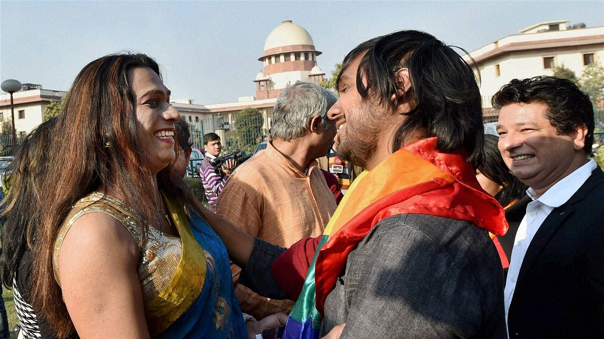 Gay rights supporters celebrate outside the Supreme Court in New Delhi on Tuesday.