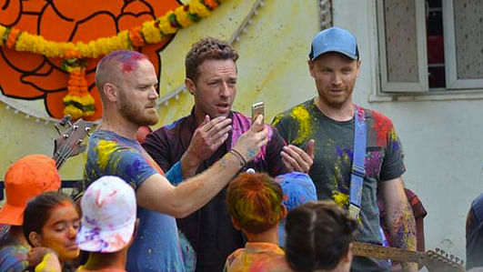"""Drummer Will Champion, lead singer Chris Martin and lead guitarist Jonny Buckland at the shoot of the video for <i>Hymn for The Weekend. </i>(Photo Courtesy:<a href=""""https://twitter.com/TBReporter/status/641916959777517568""""> Twitter/@TBReporter</a>)"""