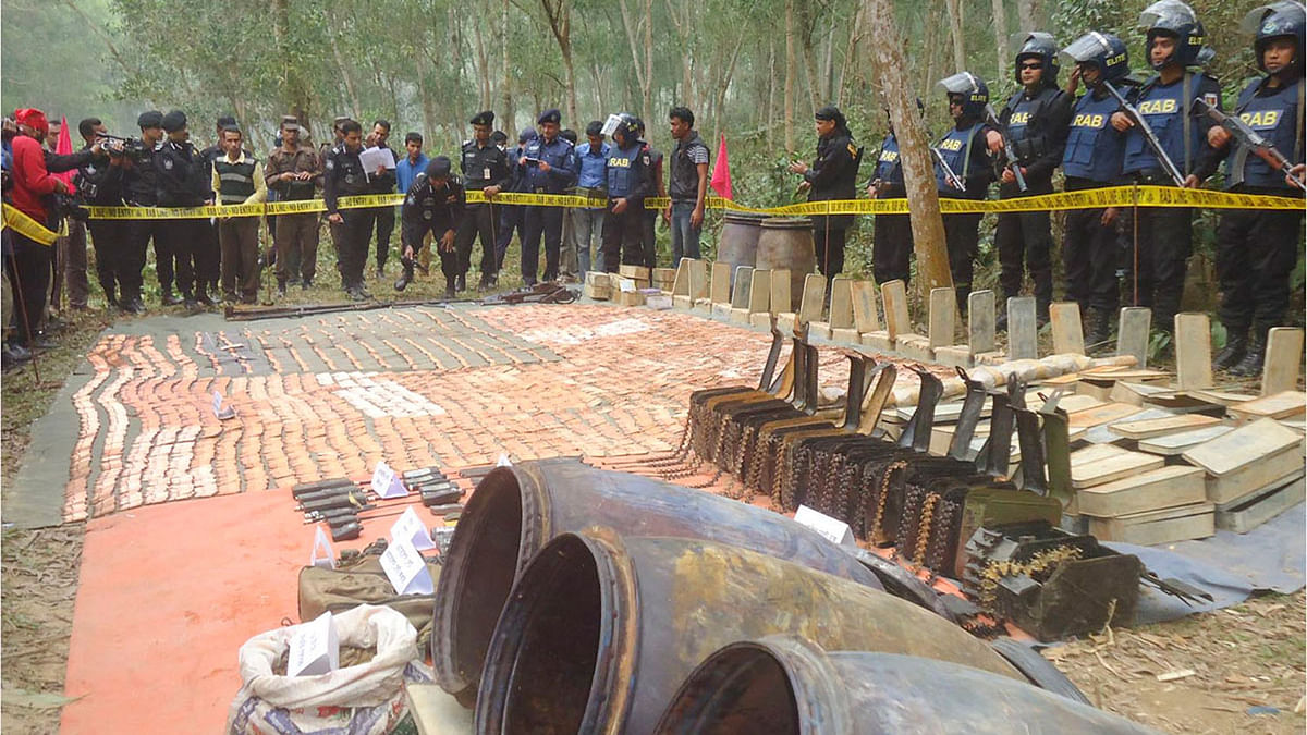 Bangladesh's elite Rapid Action Battalion (RAB) on Monday recovered a huge cache of arms from Sherpur's Jhenaigati Upazila. (Photo courtesy: bdnews24.com)