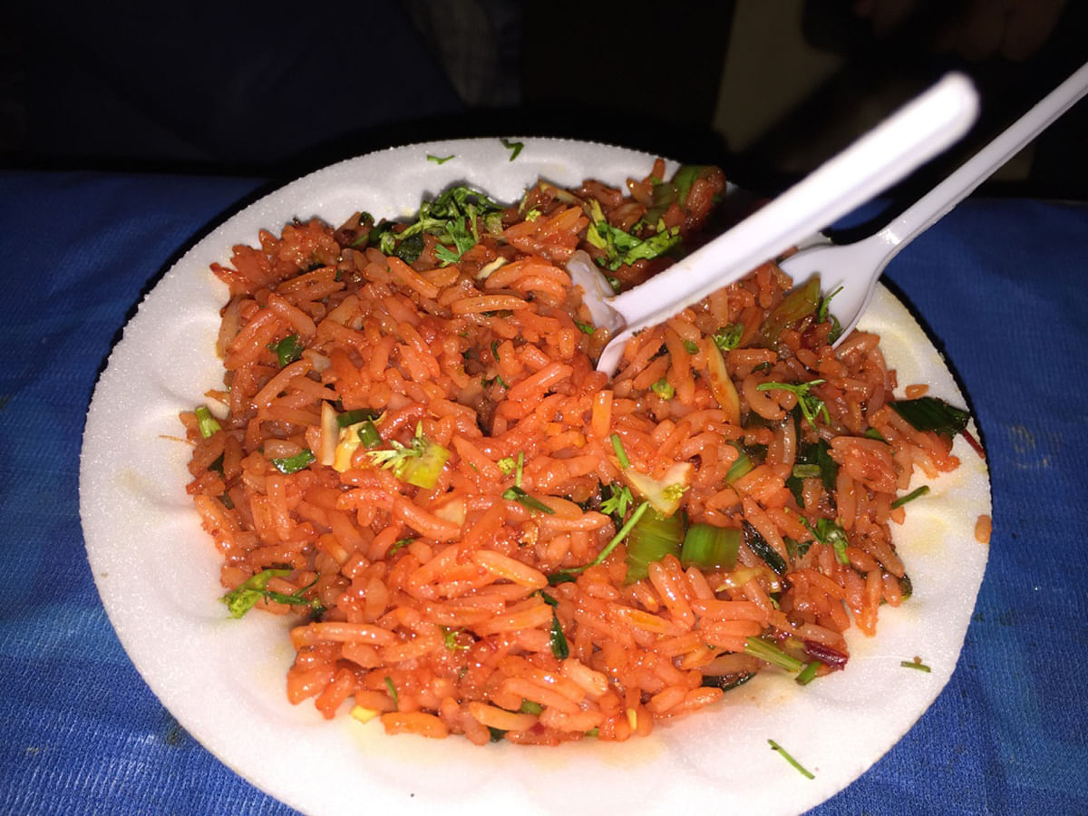 We were served a healthy helping of delicious Schezwan rice, cooked over a bonfire. (Photo Courtesy: Radhika Sharma)