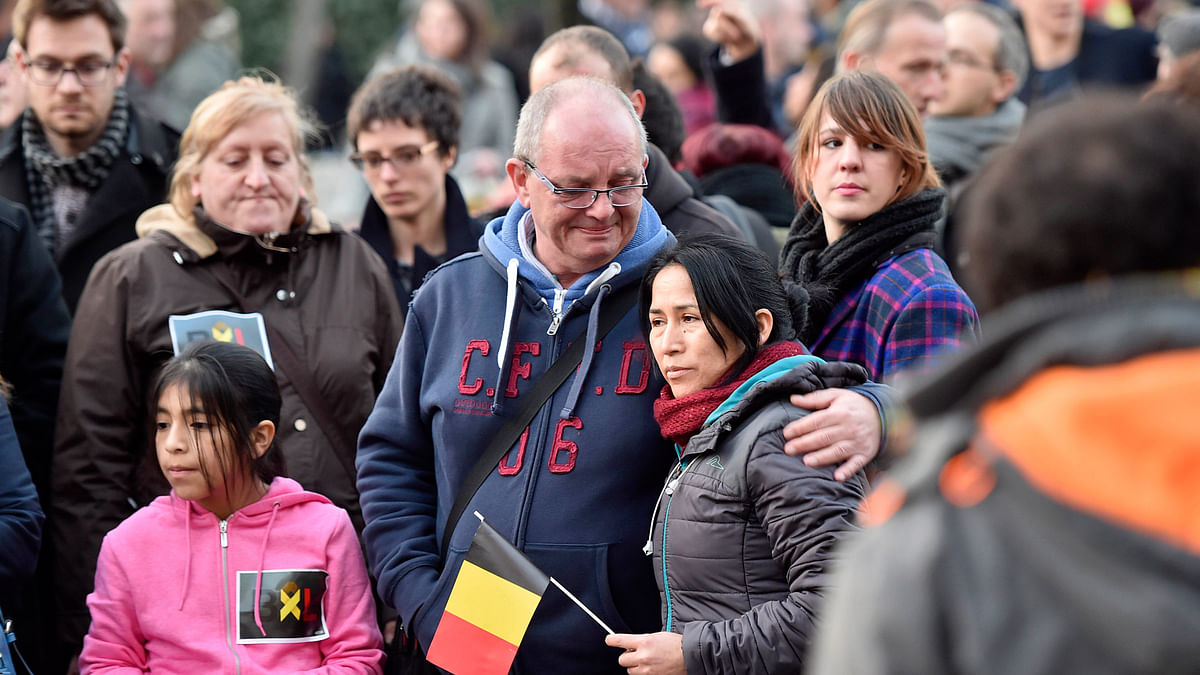 People mourn for the victims at Place de la Bourse in the center of Brussels, Tuesday, March 22, 2016. (Photo: AP)