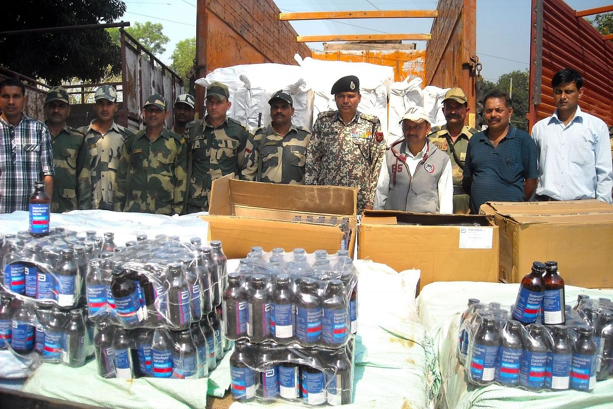 The cough syrups were being smuggled to Bangladesh concealed under fruit cartons in three trucks. (Photo Courtesy: IANS)