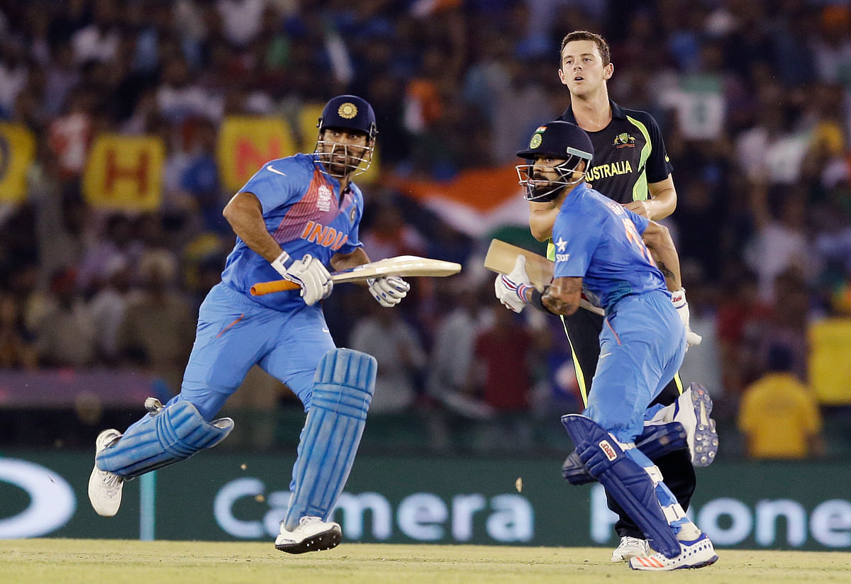 Dhoni and Kohli in action against Australia (Picture: AP)