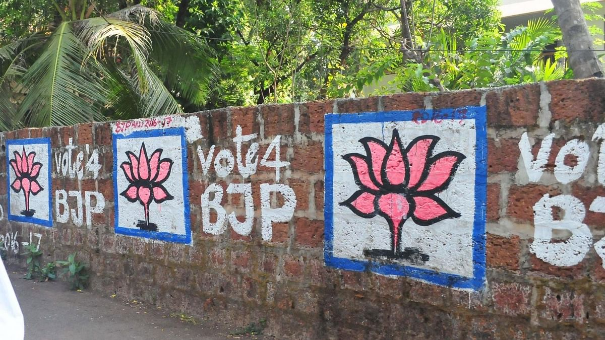 BJP graffitis on a wall in Kannur of Kerala ahead of state assembly polls on March 15, 2016. (Photo: IANS)