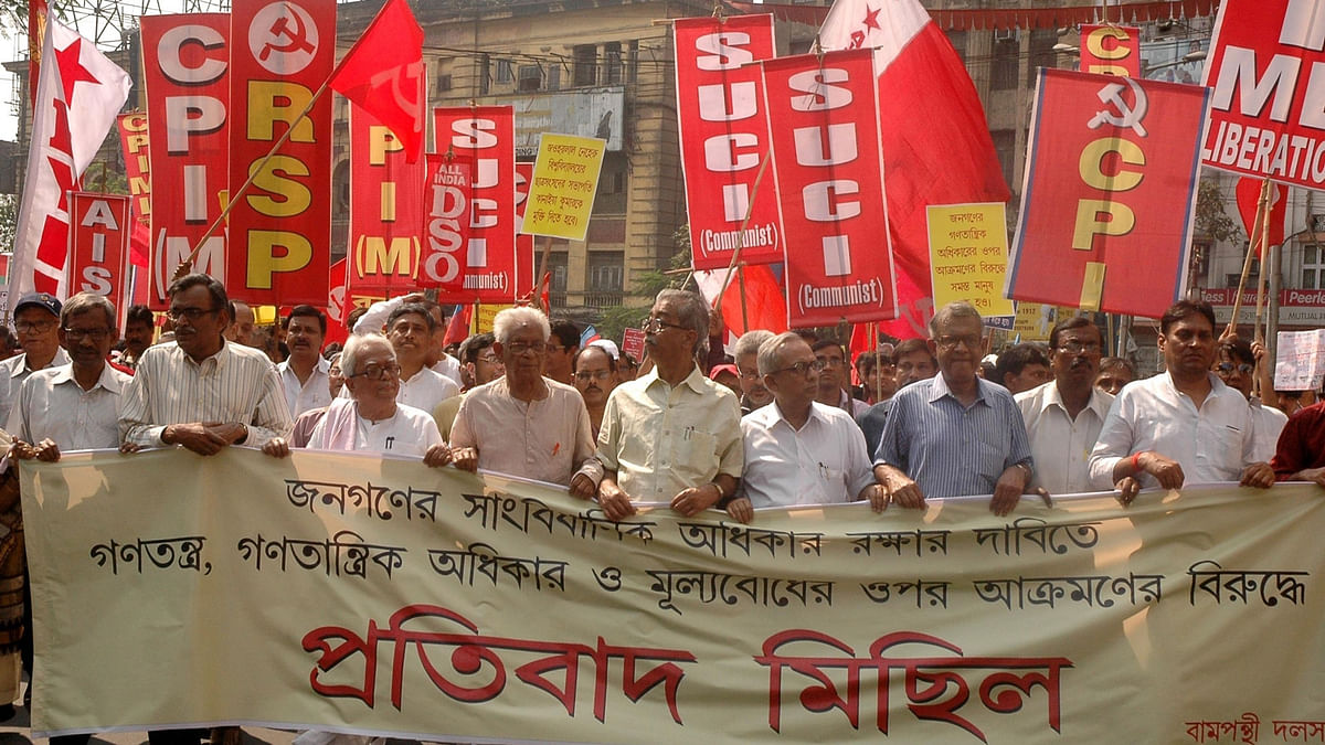Left Front Chairman Biman Bose, CPI(M) State Secretary Surjya Kanta Mishra and others participate in a protest rally against the West Bengal and the central governments in Kolkata on Feb 21, 2016. (Photo: IANS)