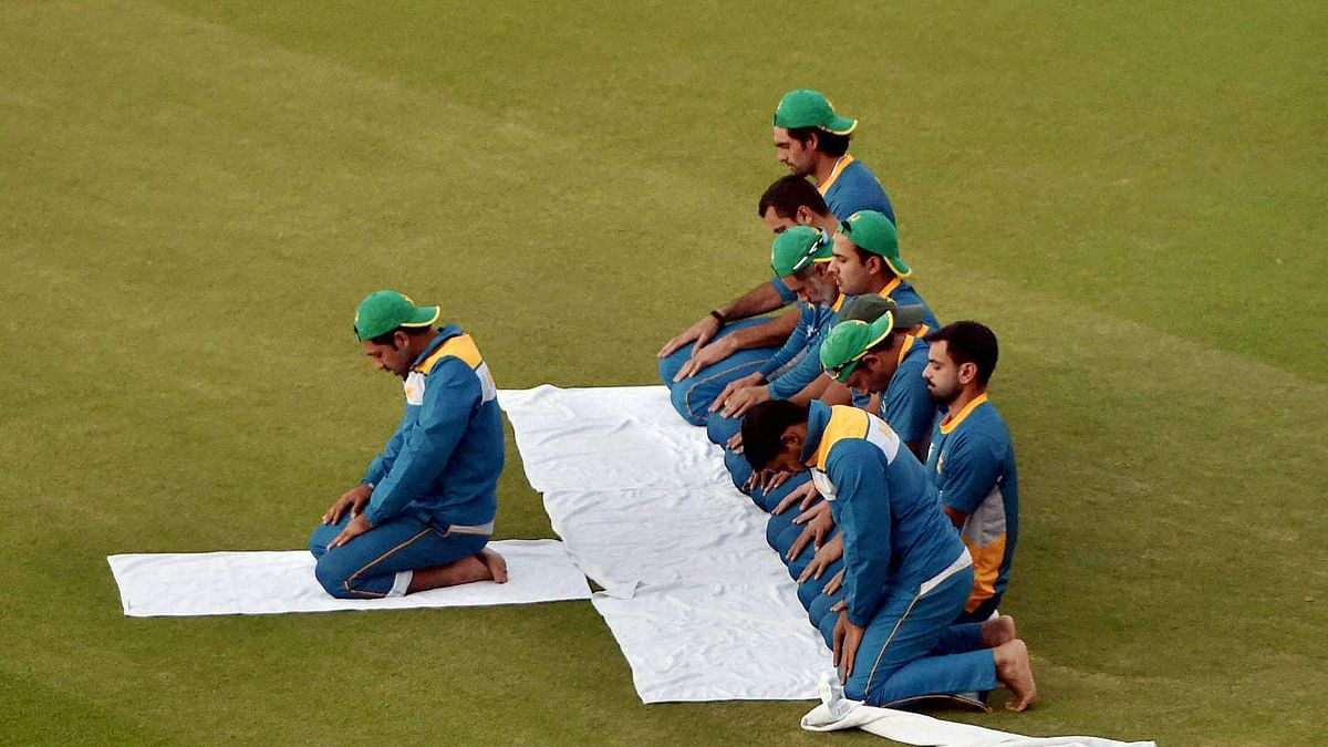 Pakistan's cricket team offering namaz after a training session at PCA Mohali on the eve of World Cup T20 match against New Zealand on Monday. (Photo: PTI)