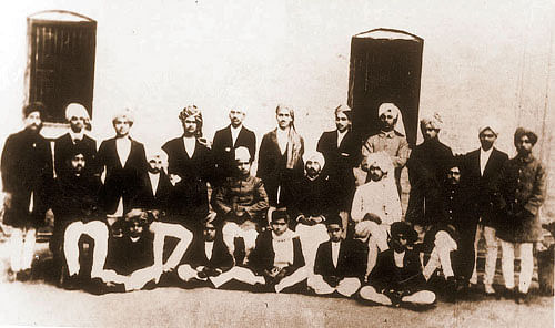 In this historical photograph of students and staff of National College, Lahore, Singh can be seen standing fourth from the right. (Photo courtesy: Wikimedia Commons