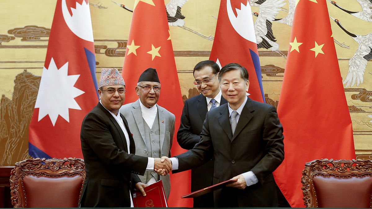 Chinese Premier Li Keqiang, rear right, with Nepal's Prime Minister Khadga Prasad Oli, rear left, attend a signing ceremony at the Great Hall of the People Monday, 21 March 2016 in Beijing, China.