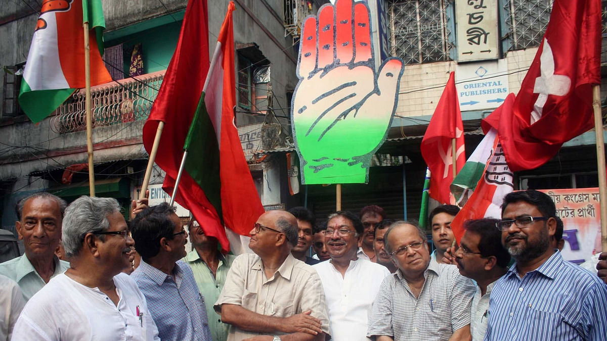 Congress leader Somen Mitra, CPI(M)'s  Rabin Deb and Former Supreme Court judge Ashok Ganguly during an election campaign  in Kolkata, on March 28, 2016. (Photo: IANS)