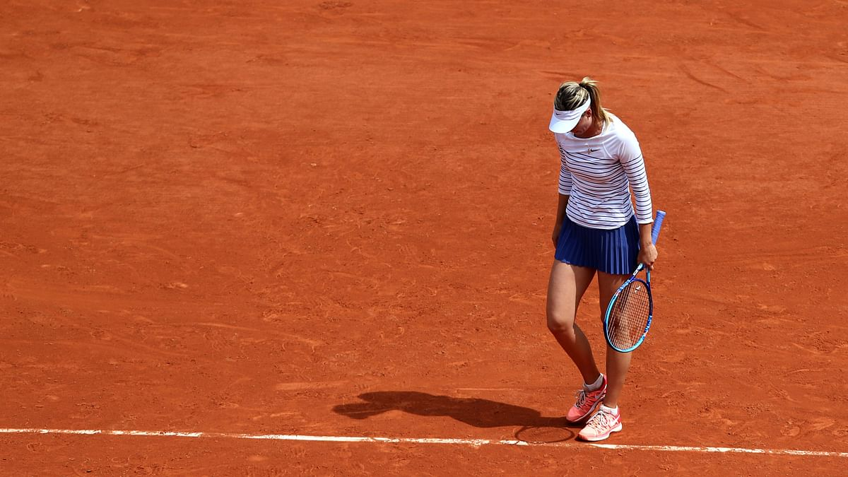 Maria Sharapova of Russia reacts during a match   at 2015 French Open tennis tournament at Roland Garros, in Paris, France, on June 1, 2015. (Photo: IANS)