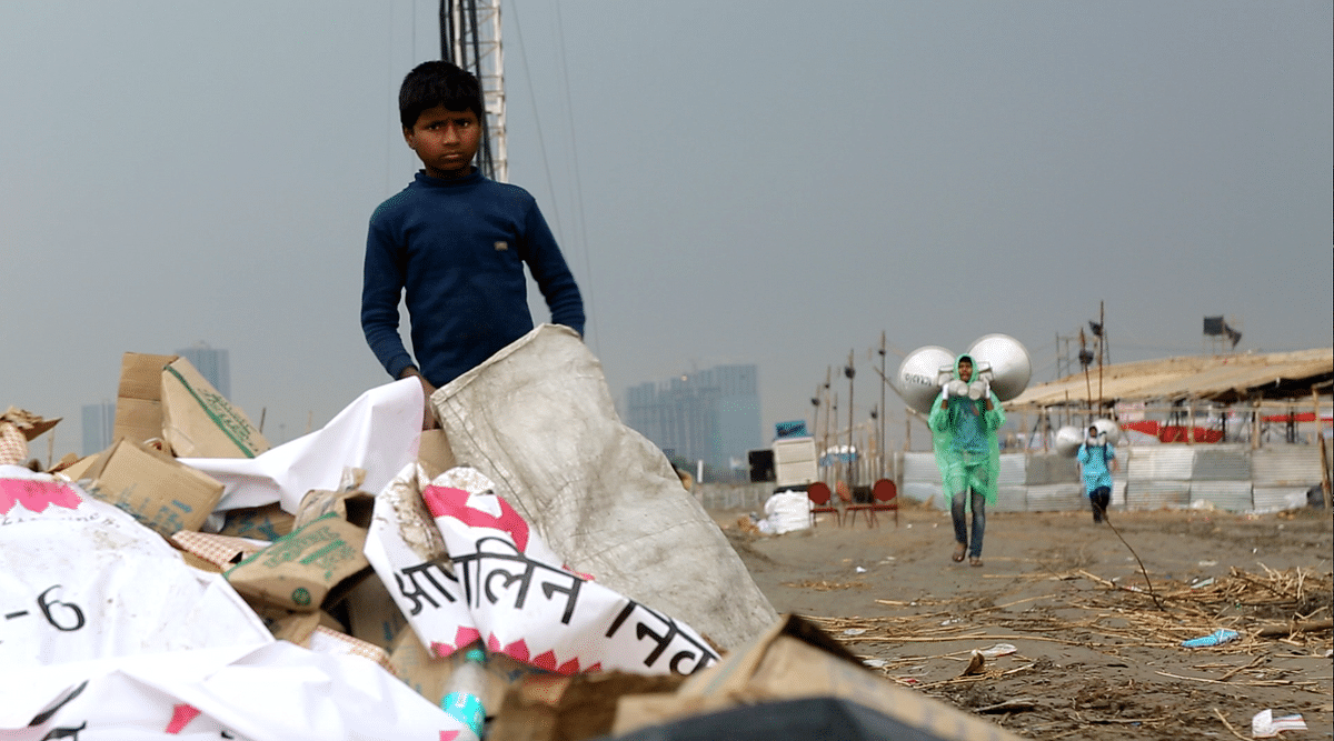 Rag-pickers go through the trash left by tens of thousands of Art of Living devotees. (Photo: Sanjoy Deb)