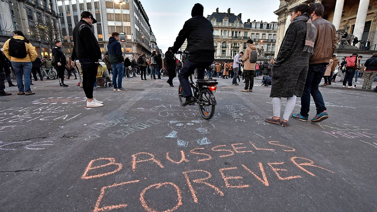 """A writing on the asphalt reads """"Brussels forever"""" at the place de la Bourse in the centre of Brussels. (Photo: AP)"""