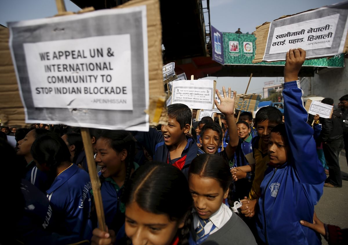 Nepalese students holding placards take part in a protest to show solidarity against the border blockade in Kathmandu, Nepal November 27, 2015. (Photo: Reuters/Navesh Chitrakar)