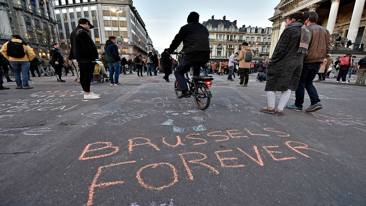 """A writing on the asphalt reads """"Brussels forever"""" at the place de la Bourse in the center of Brussels, where people write hundreds of messages on the ground to remember the victims of todays attack. (Photo: AP)"""