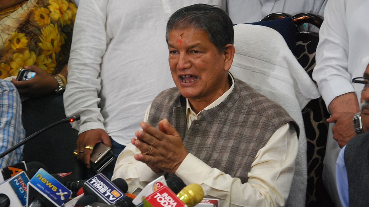 File photo of Uttarakhand Chief Minister Harish Rawat addressing a press conference in Dehradun. (Photo: IANS)