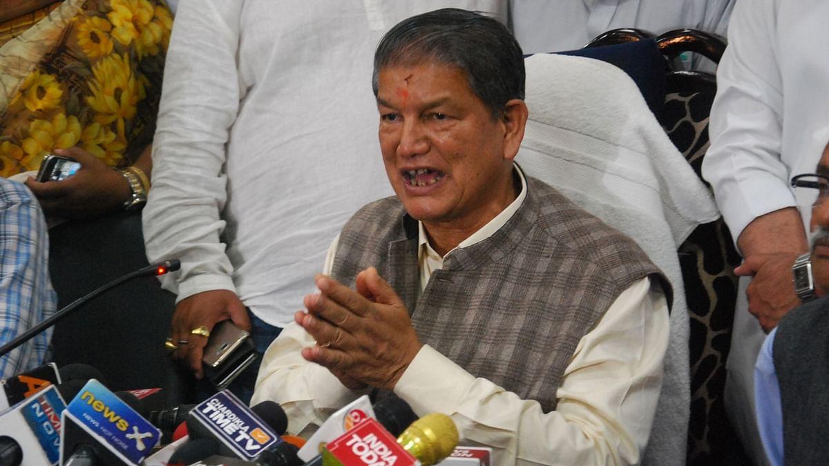 The deposed  Chief Minister of Uttarakhand, Harish Rawat addresses a press conference in Dehradun. (Photo: IANS)