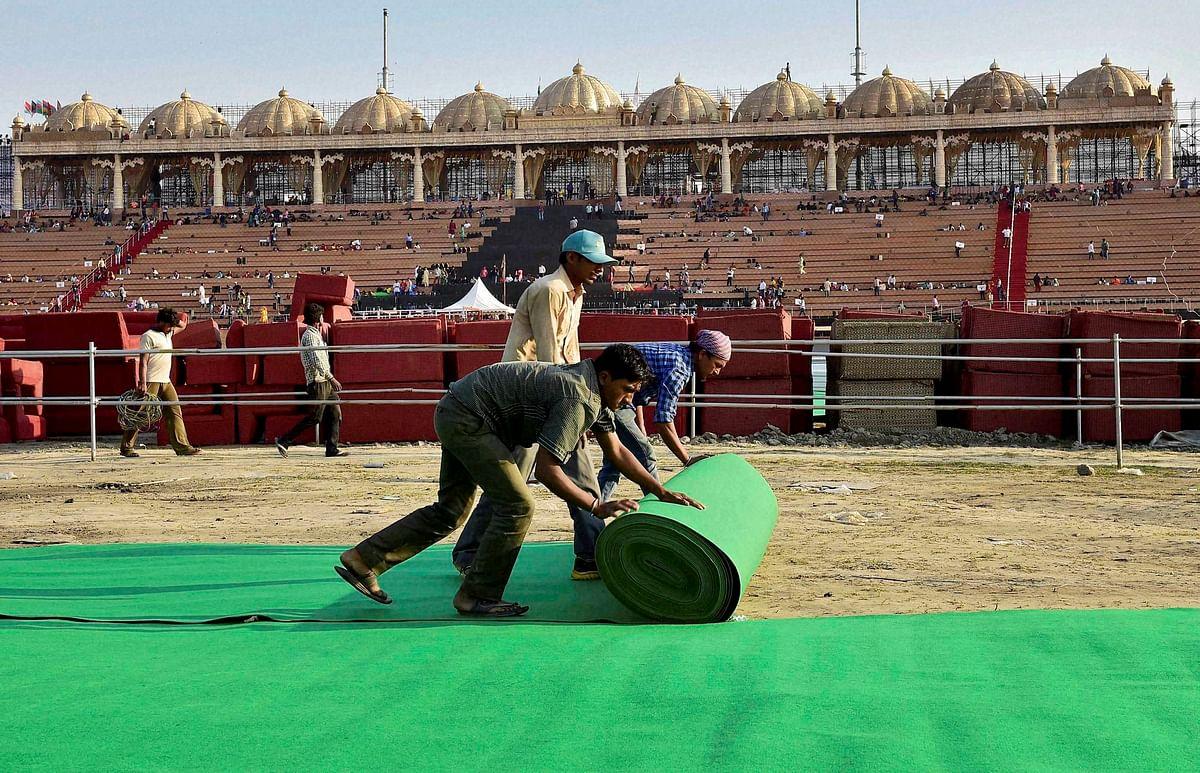 Workers make arrangements for the three-day World Peace Festival organised by spiritual guru Sri Sri Ravi Shankar in New Delhi on Wednesday. (Photo: PTI)