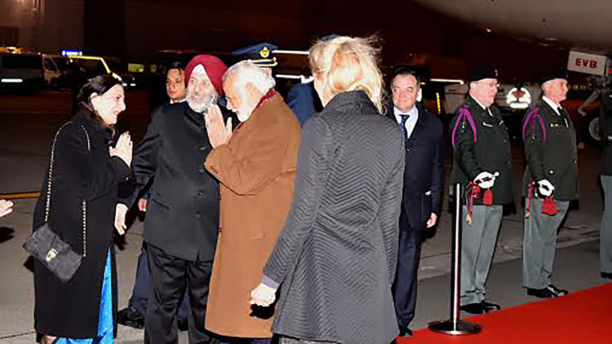 """Prime Minister Narendra Modi at the Brussels Military airport. (Photo Courtesy: <a href=""""https://twitter.com/PIB_India/status/715054329904963585"""">Twitter</a>/PIB)"""
