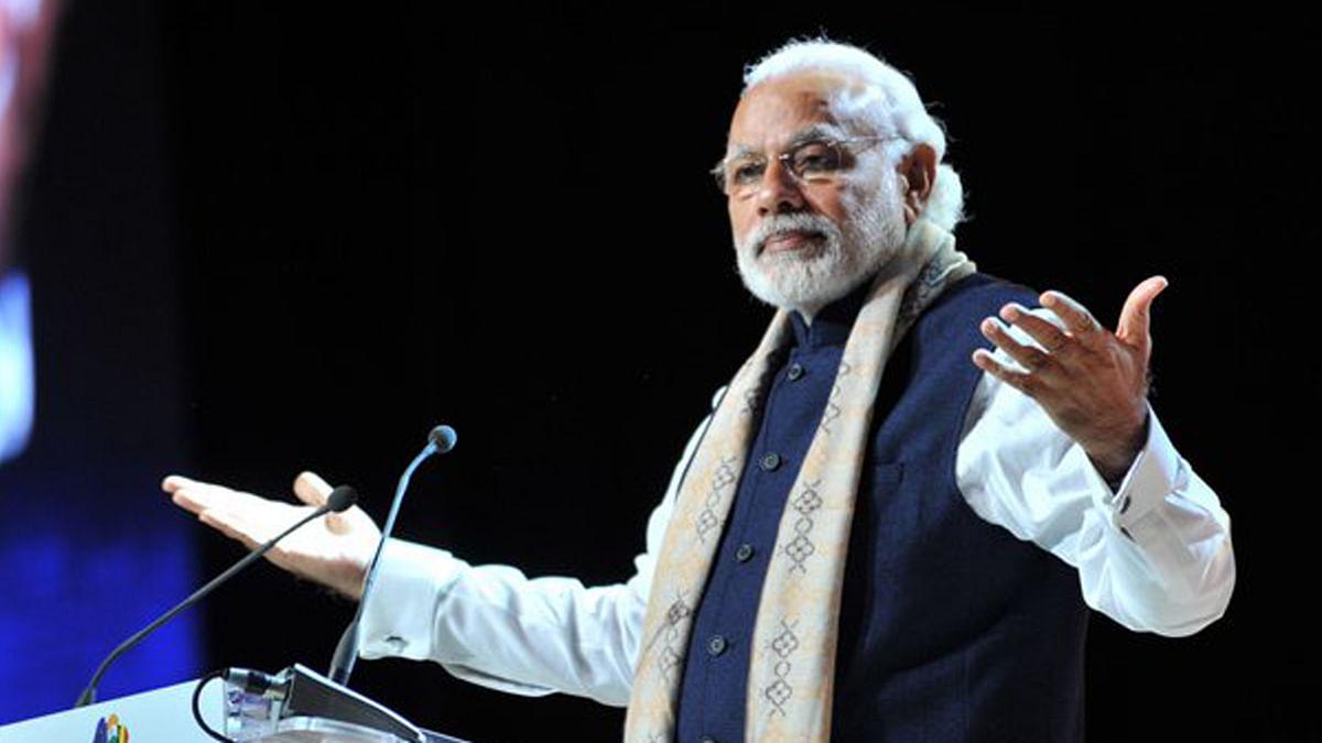 "Prime Minister Narendra Modi addresses Indian diaspora in Brussels. (Photo Courtesy: <a href=""https://twitter.com/MEAIndia"">twitter.com/MEAIndia</a>)"