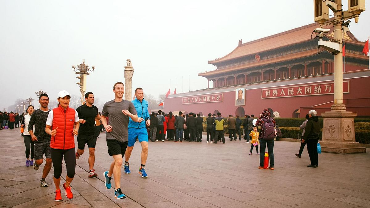 """Mark Zuckerberg posted a photo of himself running through smog in Beijing's Tiananmen Square, past the portrait of the late Chairman Mao Zedong hanging over the Forbidden City. (Photo: Facebook/<a href=""""https://www.facebook.com/zuck?fref=ts"""">Mark Zuckerberg</a>)"""