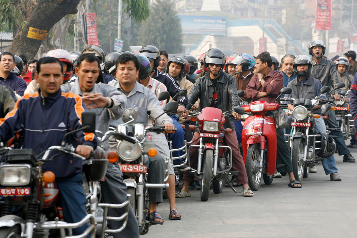 Nepali riders wait in a long queue to refill their bikes at a semi-government petrol station in Kathmandu, April 17 2006. (Photo: Reuters/Gopal Chitrakar)