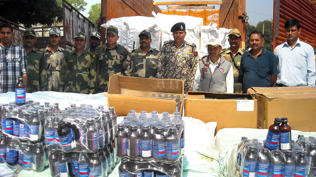 BSF officials present before press cough syrup bottles worth Rs One crore that were seized from Bhagalpur border outpost, near Agartala on 15 March 2015.  (Photo Courtesy: IANS)