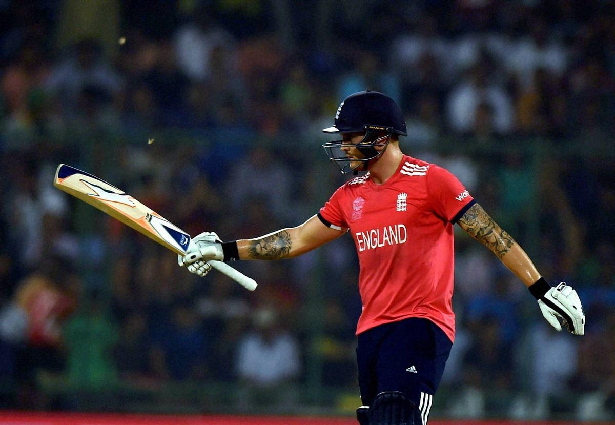 Jason Roy raises his bat after scoring a half-century. (Photo: PTI)