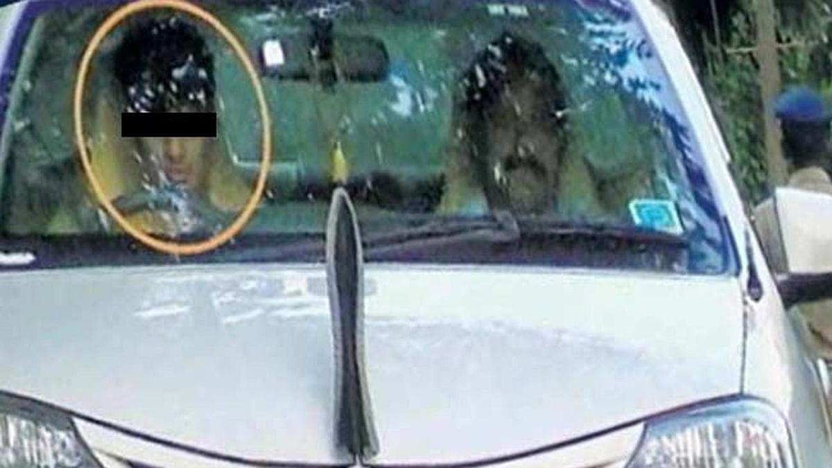 """IGP Suresh Rajpurohit's son driving the police vehicle. (Photo Courtesy: <a href=""""http://www.dekhnews.com/minor-ig-son-drive-official-car-in-kerala-juvenile-court-orders-registration-of-case-and-probe/"""">DekhNews</a>)"""