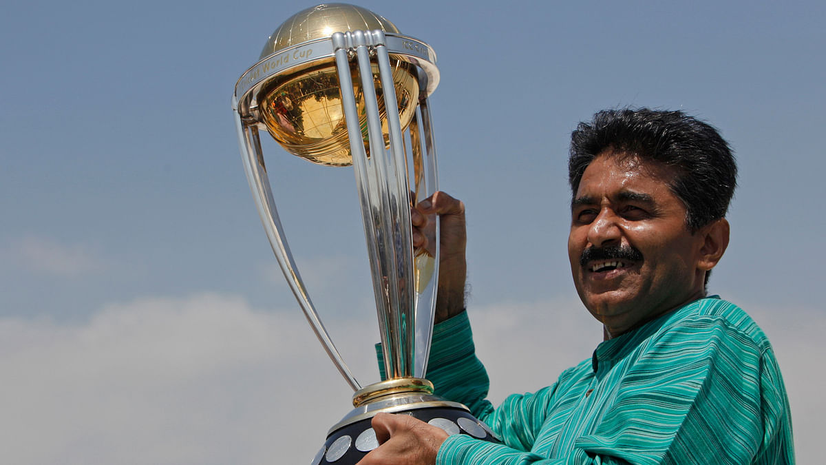 Former Pakistani cricketer Javed Miandad with the World Cup trophy.