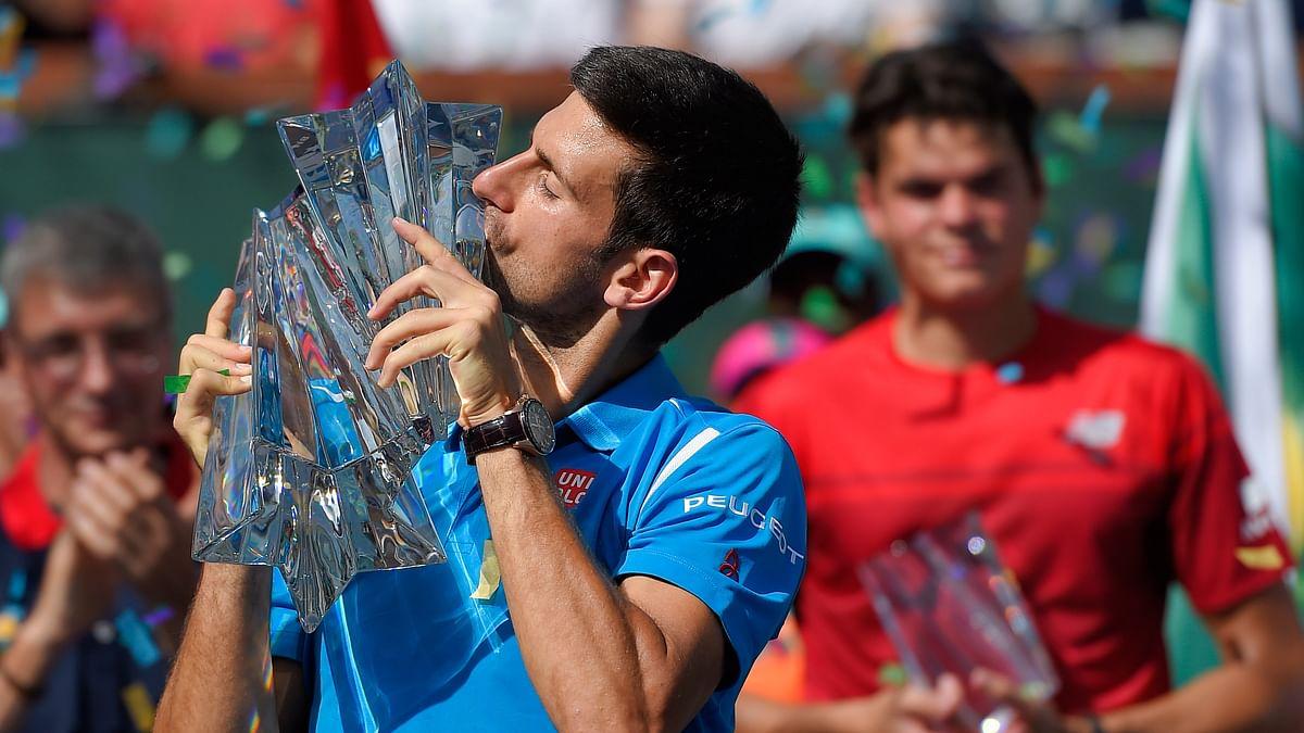 Novak Djokovic kisses the BNP Paribas Open trophy after beating Milos Raonic in the final. (Photo: AP)