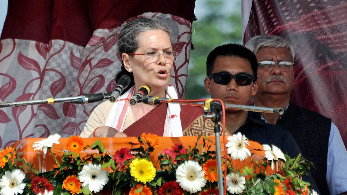 Congress president Sonia Gandhi addresses the gathering at an election rally at Biswanath Chariali in Sonitpur district of Assam on Wednesday. (Photo: PTI)