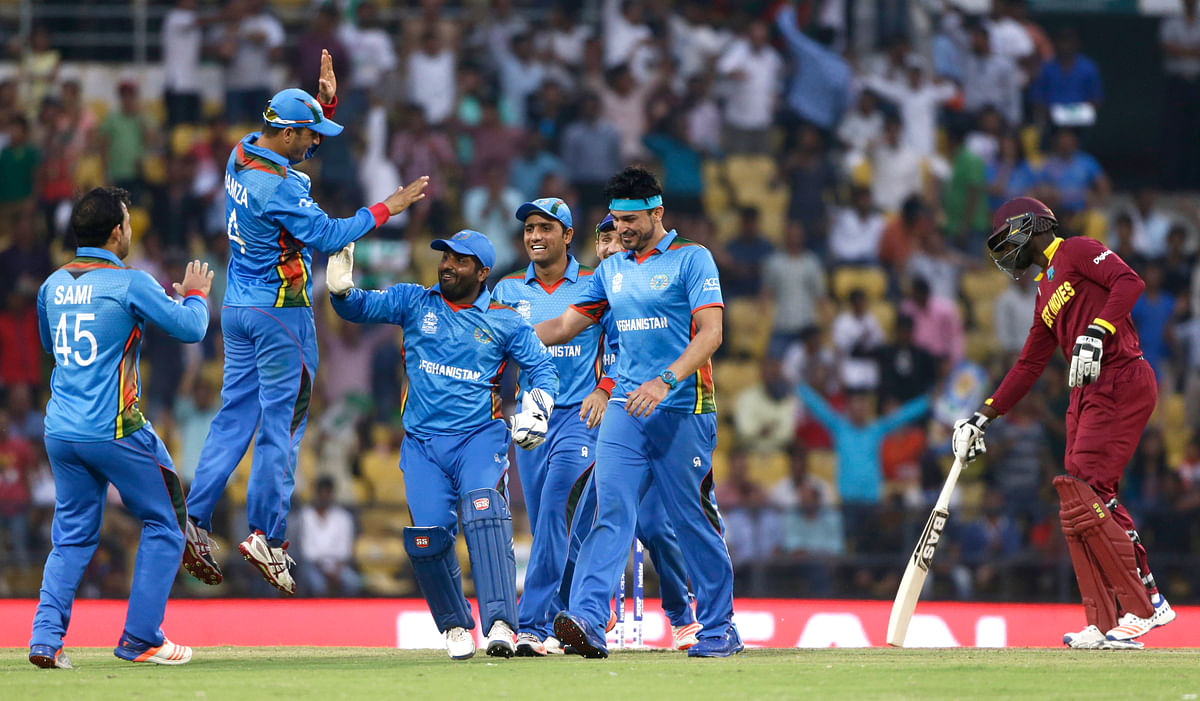 Afghanistan's players celebrate the run out of West Indies' Andre Russell (Picture: AP)