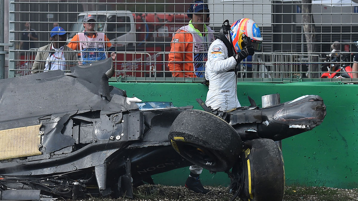 McLaren driver Fernando Alonso of Spain emerges from the wreck of his car after he collided with Haas driver Esteban Gutierrez of Mexico during the Australian Formula One Grand Prix. (Photo: AP)