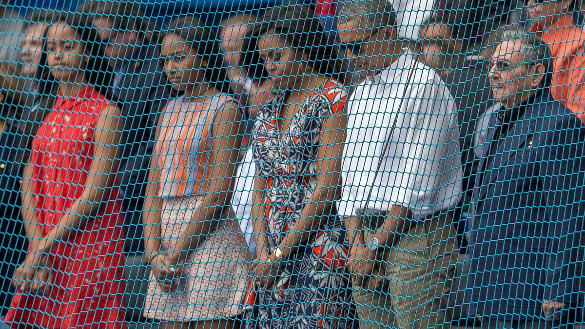 President Barack Obama, first lady Michelle,   stand with Cuba's President Raul Castro, right, during a moment of silence for the victims of attacks in Brussels,  Cuba, March 22, 2016. (Photo:PTI)