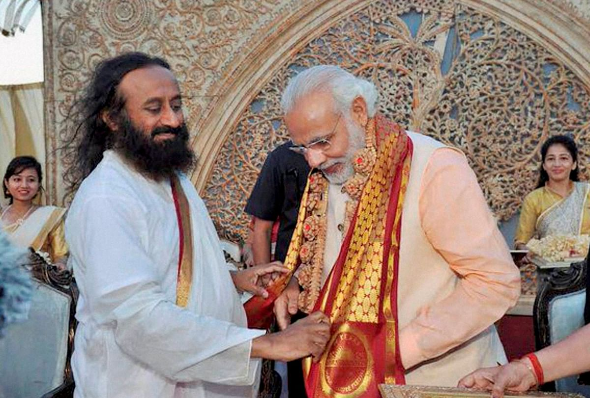 Prime Minister Narendra Modi being greeted by Art of Living founder Sri Sri Ravishankar on  the opening day of the three-day long World Culture Festival on the banks of the Yamuna  in New Delhi on Friday. (Photo: PTI)