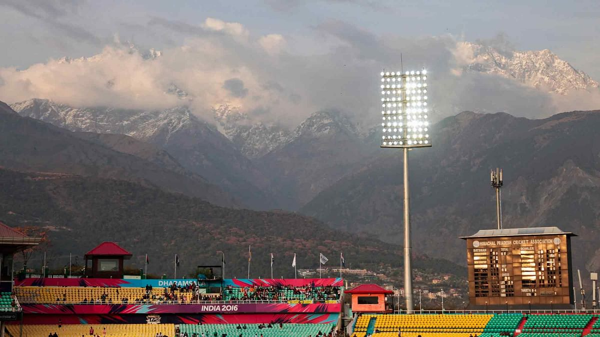 Snow-clad mountains are visible above the Himachal Pradesh Cricket Association (HPCA) stadium that was to host the India-Pak WT20 match. (Photo: AP)<a></a>