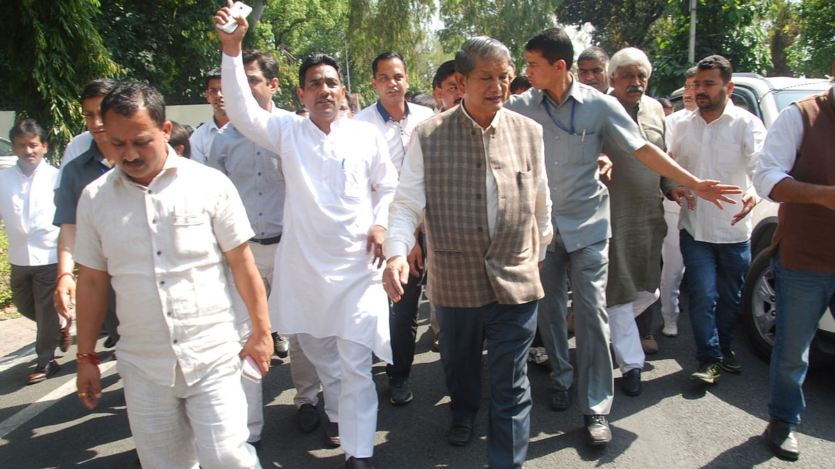 Congress and other supporting legislators led by former chief minister Harish Rawat come out after meeting Uttarakhand Governor KK Paul in Dehradun. (Photo: IANS)
