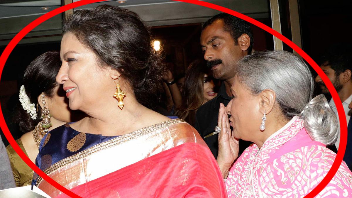 Rekha acknowledges Jaya Bachchan's flying, hidden behind Shabana Azmi (Photo: Yogen Shah)
